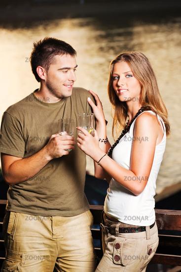 couple on terrace near river