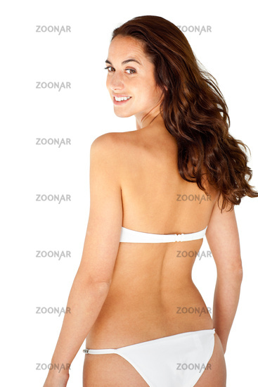 Attractive hispanic woman wearing bikini against a white background
