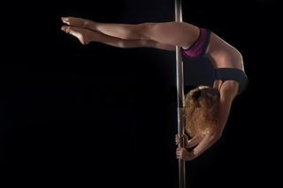 Young pole dance woman in bikini