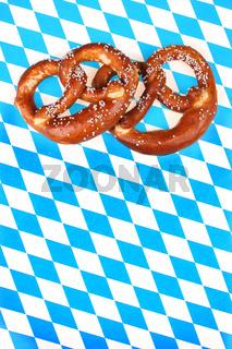 Salzbrezeln auf bayrischer Raute -bavarian  pretzel,Salty pretzels on chequered bavarian background