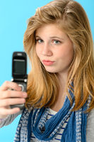 Young girl taking picture of herself