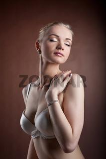 Beautiful woman portrait in white bra