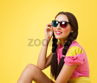 Funny woman in doll dress look in stereo glasses