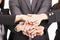 business team with hand together for teamwork conc
