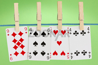 playing cards hung on clothesline