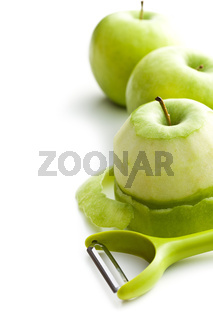 peeled green apple with peeler