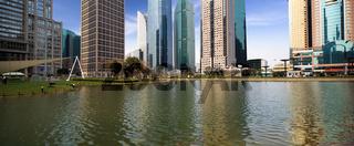 lake and modern city