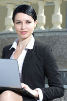 Beautiful businesswoman working outdoor