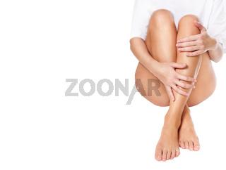 female legs being massaged