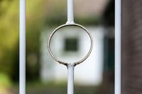 Round decorative element on an iron fence