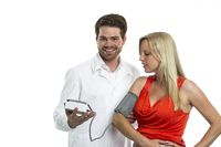 Doctor measures the blood pressure of a pregnant w