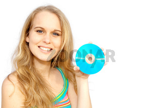 young woman  or teen holding blank cd or dvd disc