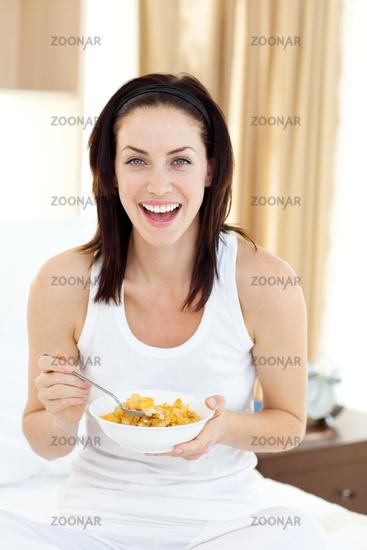 Attractive young woman having breakfast