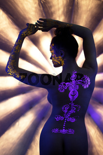 UV pattern on back of slim naked woman