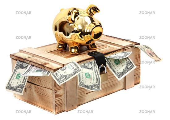 golden piggybank on wooden case with dollar notes
