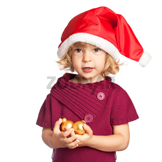 Happy girl in Santa hat with Christmas balls on white background
