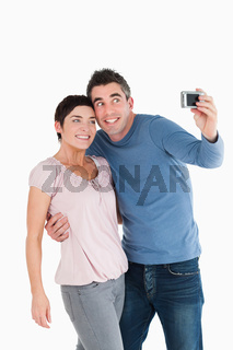 Portrait of a couple taking a picture of themselves