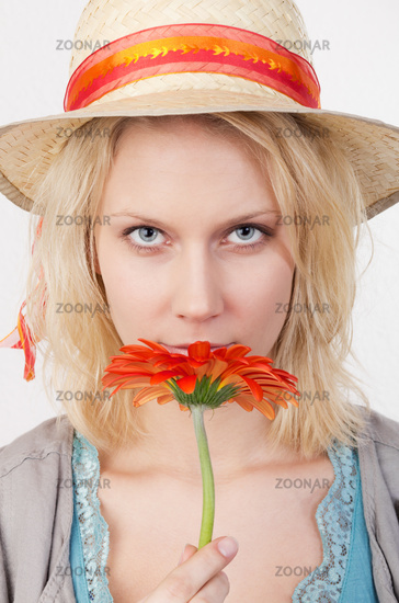 Pretty woman with red flower