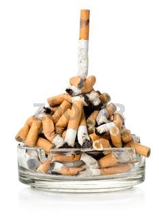 Cigarettes in a glass ashtray