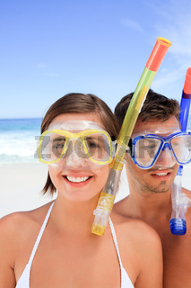 Couple with their mask at the beach