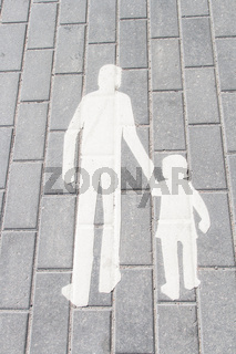 white silhouette walking adult and child on tile