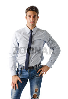 Alternative young business man wearing shirt, tie and ripped jeans