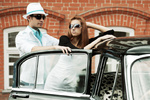 Young couple with a retro car