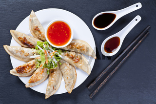 Fried Jiaozi with dipping sauces