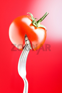 Red tomato with mouth on red background