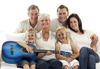 Portrait of family playing guitar at home