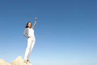 Woman success top of mountain