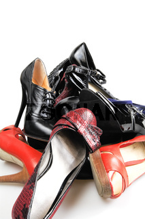 Heap of old female leather footwear on a high heel