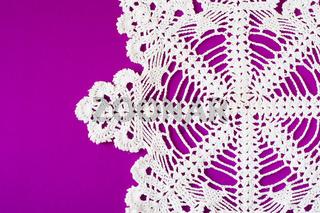 white decorative serviette on purple background