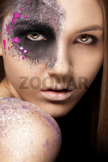 Portrait of a young woman with artistic make up