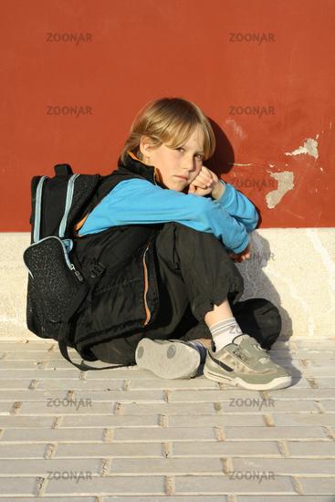 sad lonely bullied school kid, child, student or b