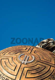 Euro symbol on a shield against a blue sky