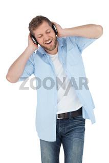 Trendy model listening to music