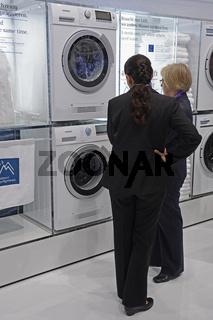 Besucherin interessiert sich fuer die neuesten Waschmaschinen auf der Internationalen Funkausstellung IFA 2012 in Berlin, Deutschland, Europa