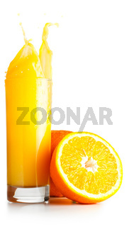 orange juice is spalsing in glass