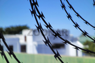 Barbed Wire with Houses behind