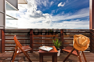 Wooden furniture on an outdoor deck