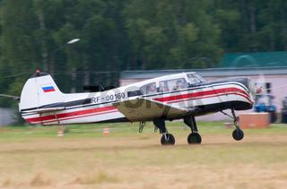 Yak-18t plane runs for takeoff