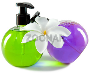 bright color cosmetic small bottles with the dispenser and white flower