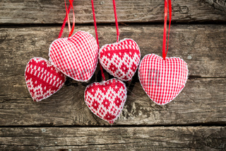 Hearts on wooden background