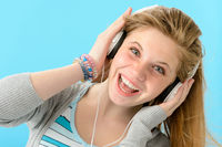 Cheerful girl listening to music with headphones