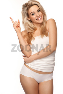 Beautiful blonde woman pointing upwards