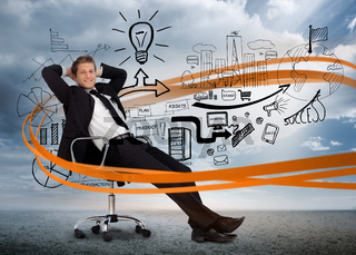 Businessman sitting in front of detailed brainstorm
