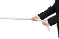 Business man hand holding or pulling rope