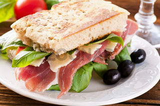 Sandwich with ham and parmesan