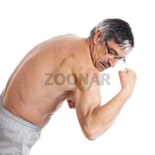 Senior man showing biceps